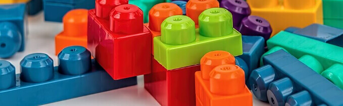 Brightly colored scattered Duplo blocks